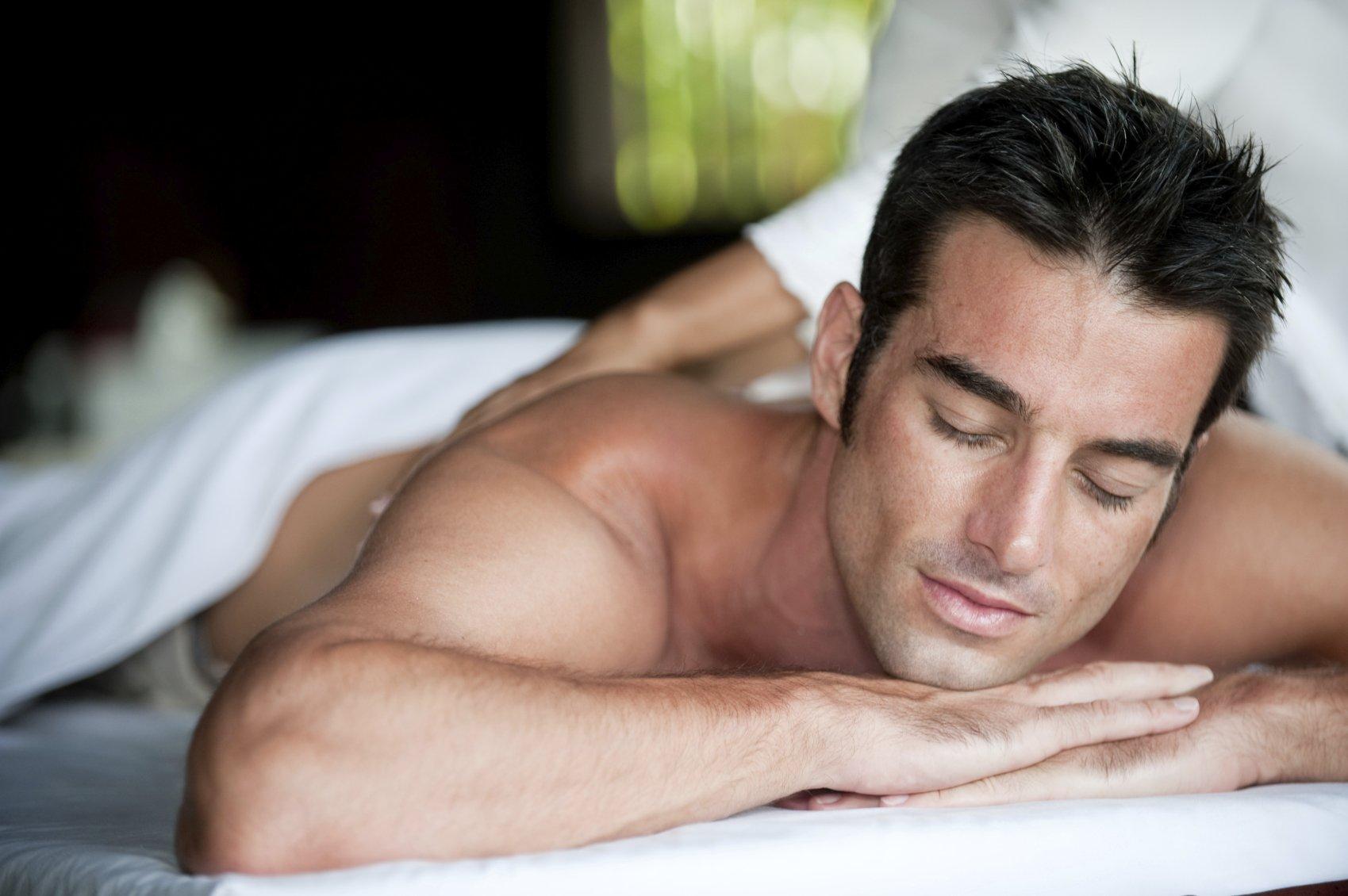 Brunette man receiving a massage lying down