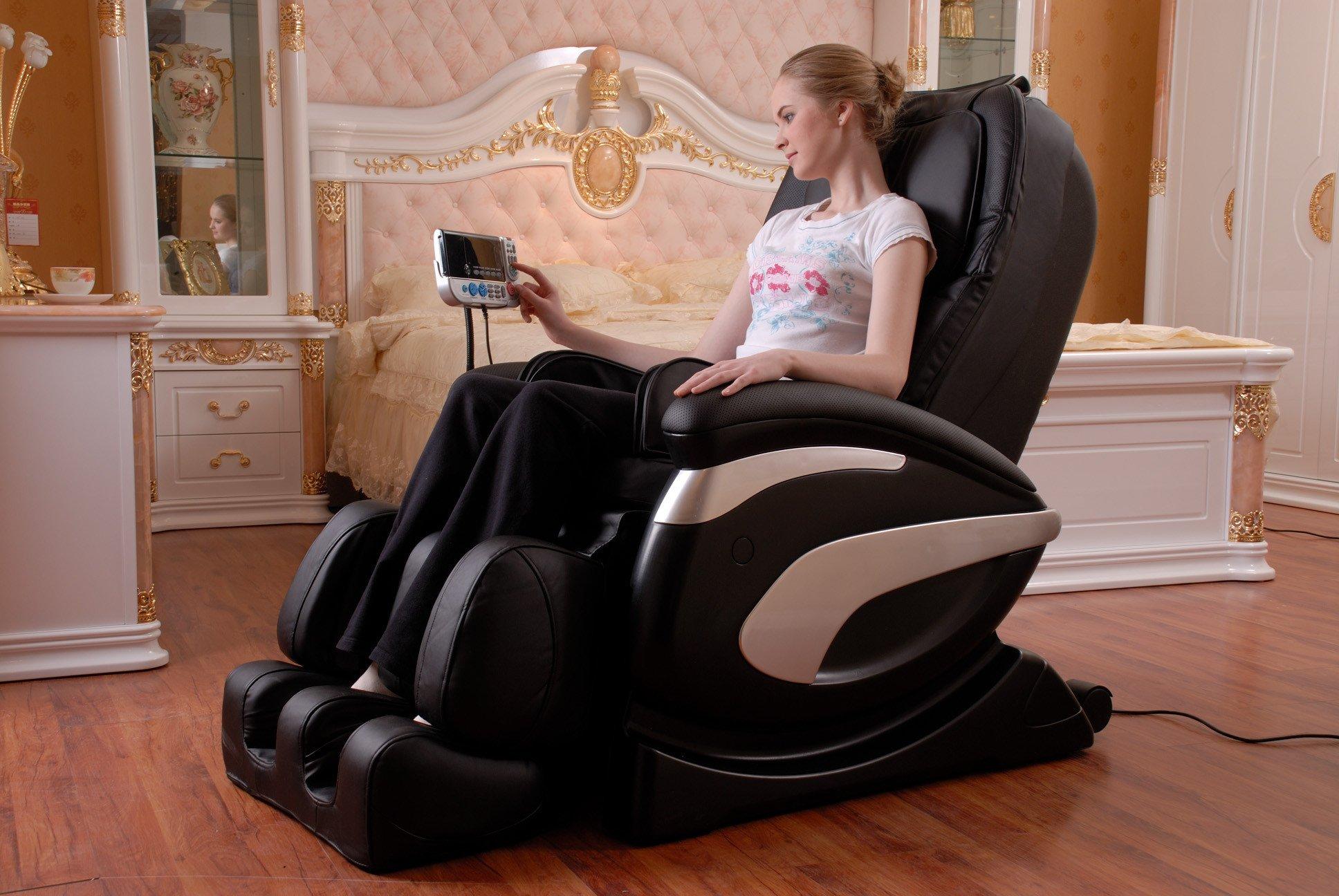 Blonde woman in fancy bedroom sitting in black massage chair