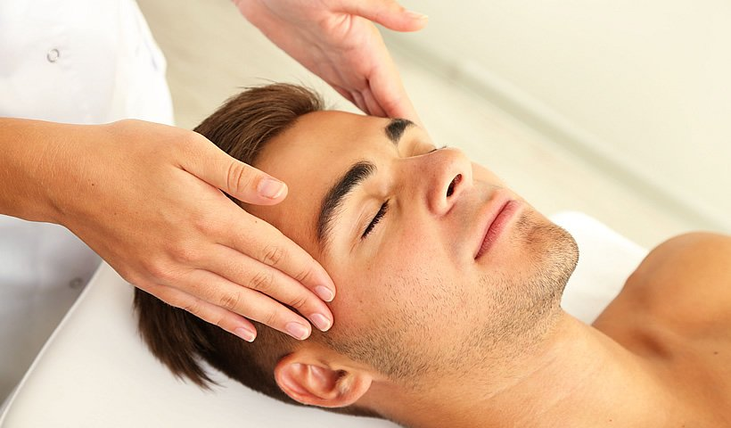 Brunette man receiving facial massage