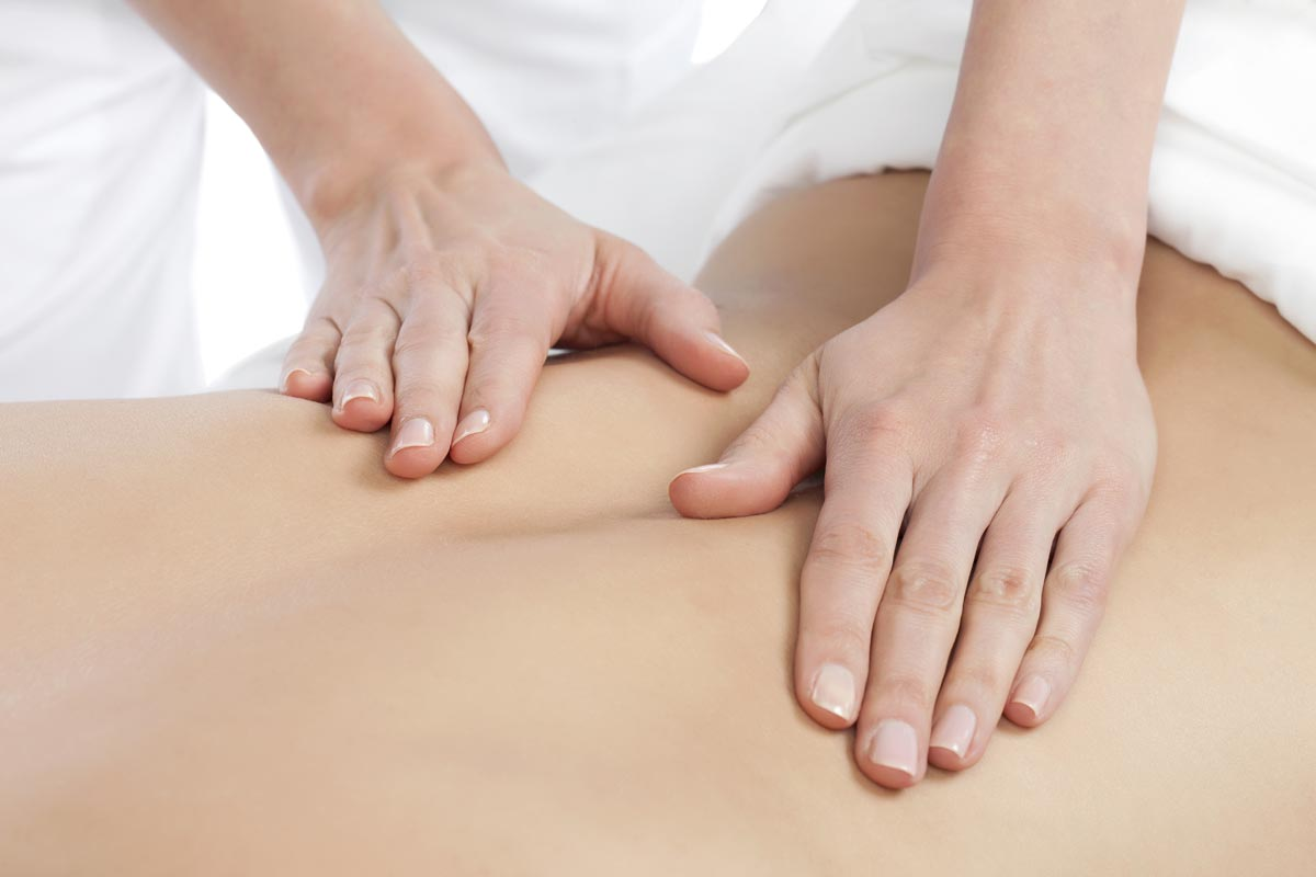 Close up of person receiving lower back massage