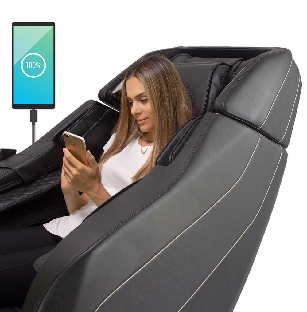 Blonde woman sitting in Black Formatica iQ Massage Chair using phone