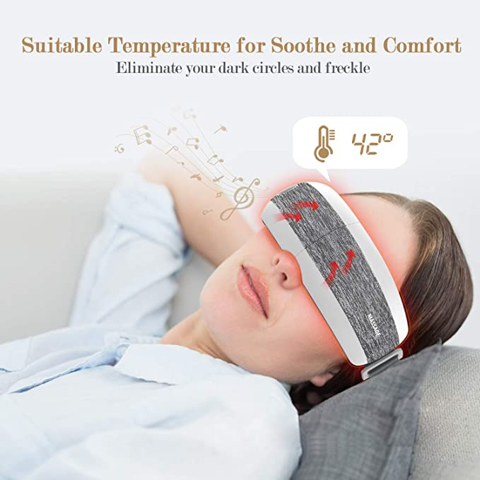 Brunette woman wearing eye massager with text showing the temperature setting